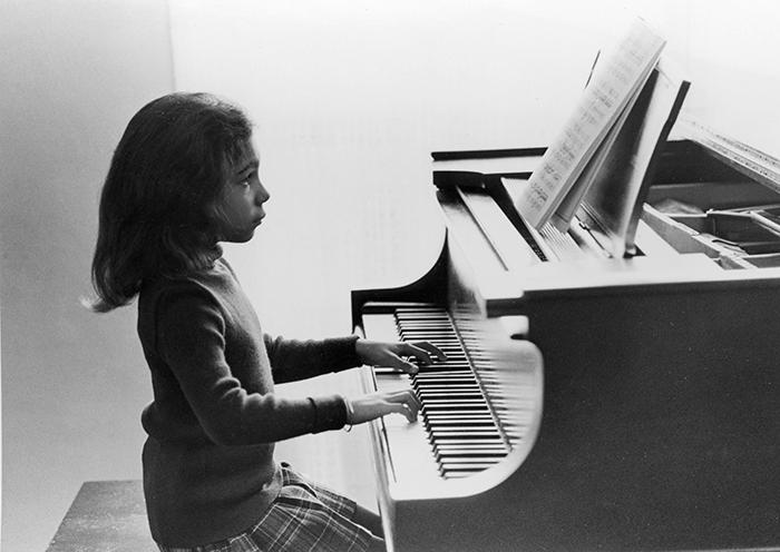 young lara playing piano
