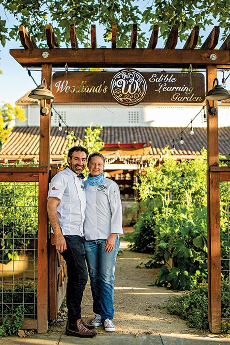 Juan Barajas and Kristin Hansen in gardens