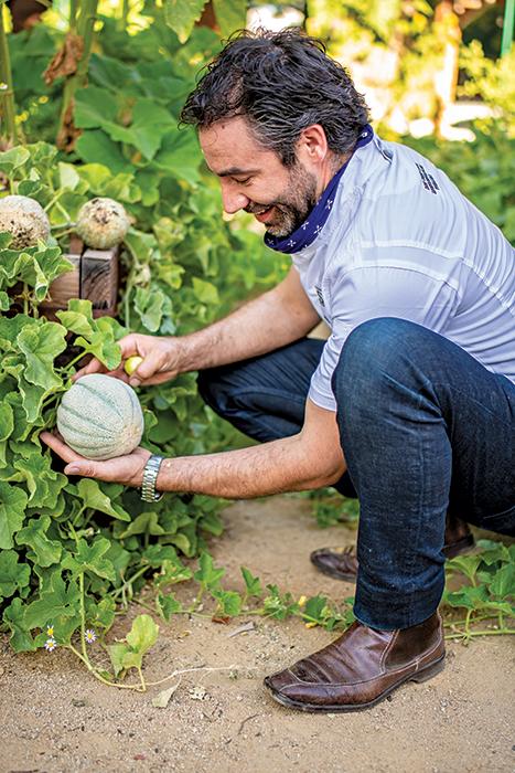 Juan Barajas standing in gardens